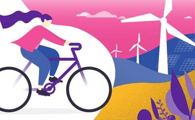 Woman cycling past windmills